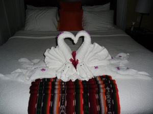 towel art on bed at Arenal Nayara Hotel in La Fortuna, Costa Rica